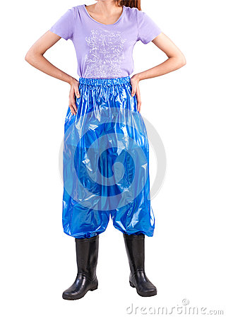 Woman wearing wet protection plastic troussers