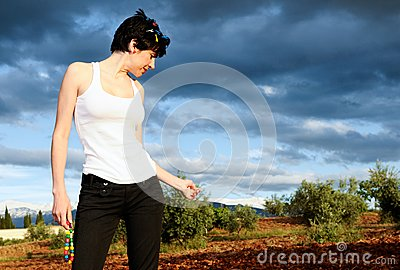 Woman wearing a white t shirt in the field