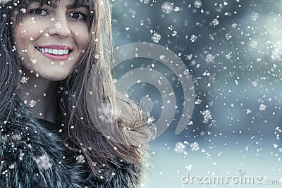 Woman wearing winter clothes, cold weather