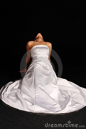 Woman in wedding dress on her knees