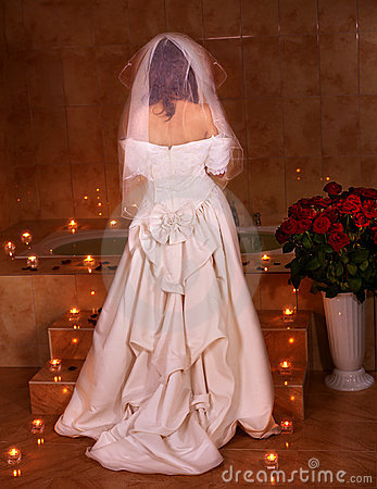 Woman in  wedding dress relaxing in sauna.
