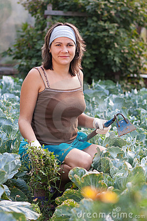 Woman weeding vegetable garden