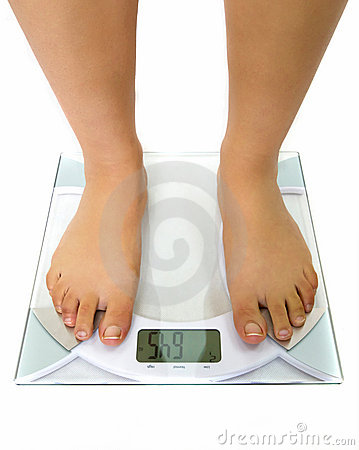 Woman on the weight scale
