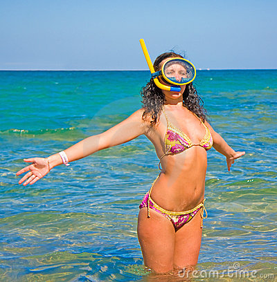 Woman welcoming summer sun