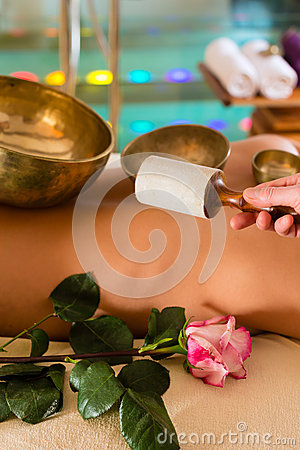 Woman at Wellness massage with singing bowls