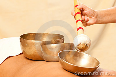 Woman and Wellness with singing bowls