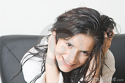 Woman with wet hair smiling