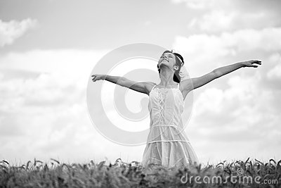 Woman in wheat field, black and white
