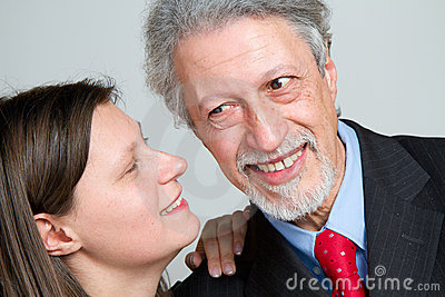 woman whispering an exciting news
