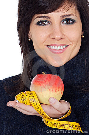 Woman whit apple and measuring tape