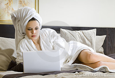 Woman in white bathrobe