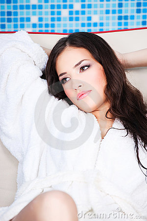 Woman in white bathrobe resting