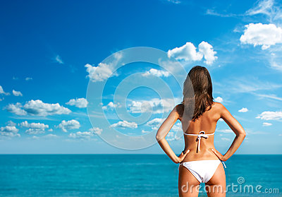 Woman in White Bikini at the Sea. Rear View.