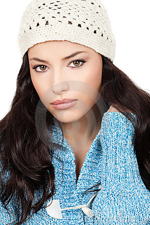 Woman with white cap and blue wool sweater