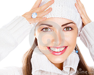 Woman in white cap and pullover. Happy smile