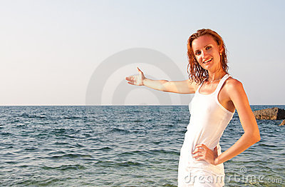 Woman in white cloth inviting to sea