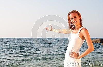 Woman in white cloth inviting to sea