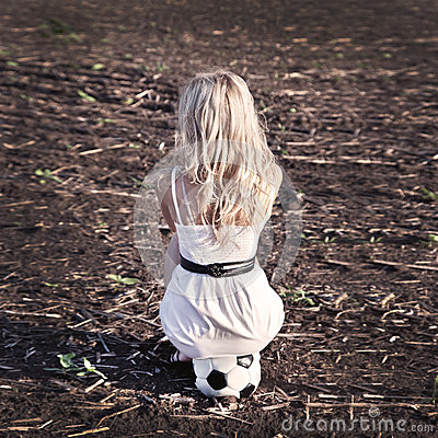 Woman in white drees sit on ball