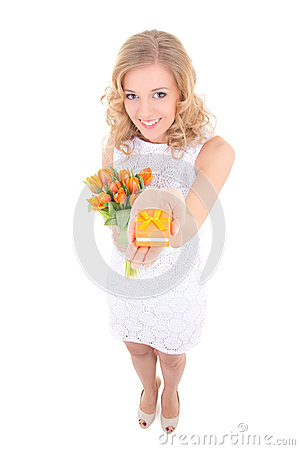 Woman in white dress with flowers and gift