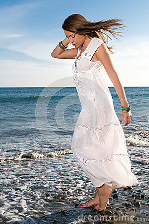 Woman in white dress near the seaside