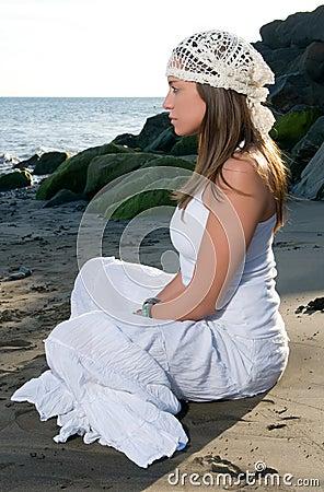 Woman in white dress near the seaside
