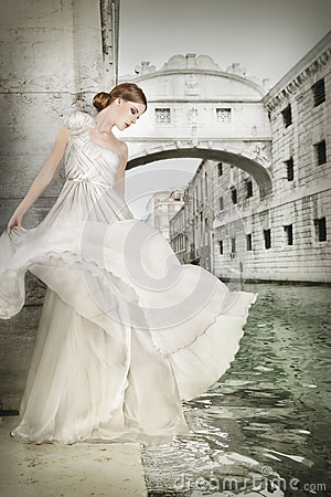 woman white dress venice italy beautiful near bridge sighs 44183648 Effective Plans Of Top Russian Brides   For Adults