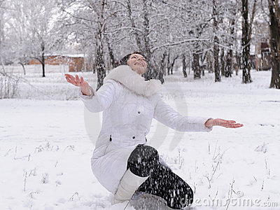 Woman in white and falling snow