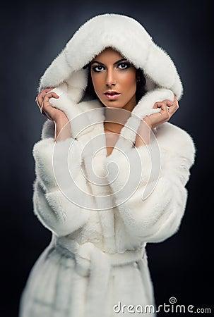 Woman In White Fur Coat Stock Photos - Image: 22822583