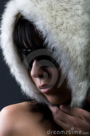 Woman in white fur hat