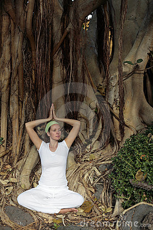 Woman in white meditating