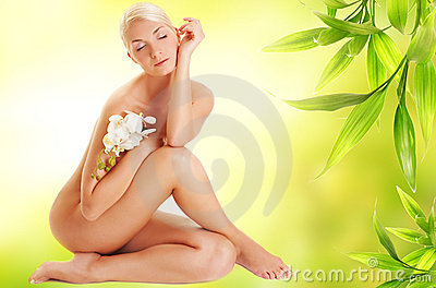 Woman with white orchid flower