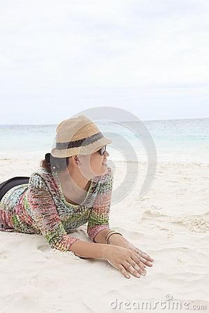 Woman on white sand beach with relax emotion