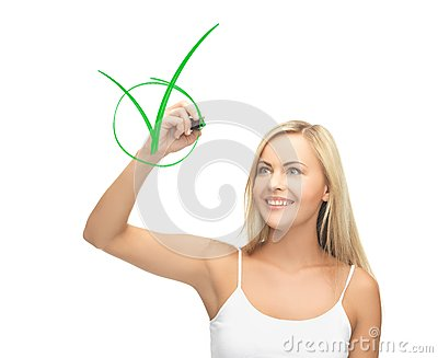 Woman in white shirt drawing green checkmark