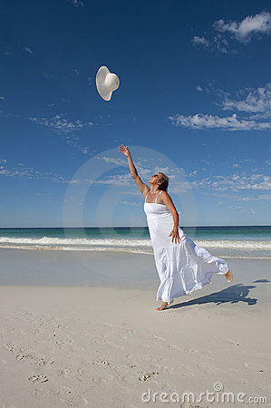 Woman in White Summer Dress on Beach