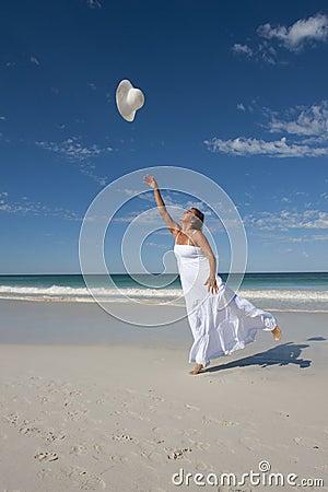Woman in White Summer Dress on Beach