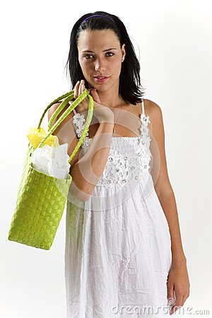 Woman in white summer dress with shopping bag