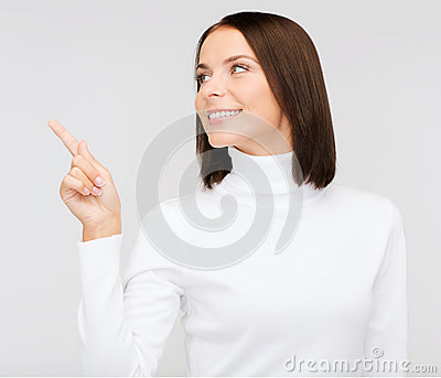 Woman in white sweater pointing to something