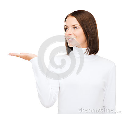 Woman in white sweater with something on palm