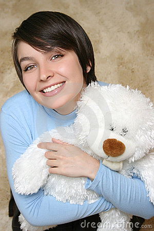 Woman with white teddy bear
