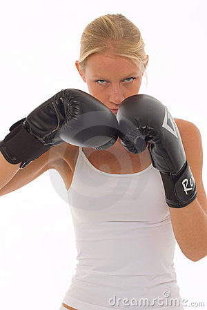 Woman who does kick boxing with boxing gloves