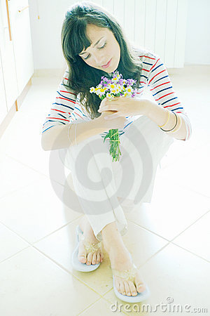 Woman with wildflower bouquet