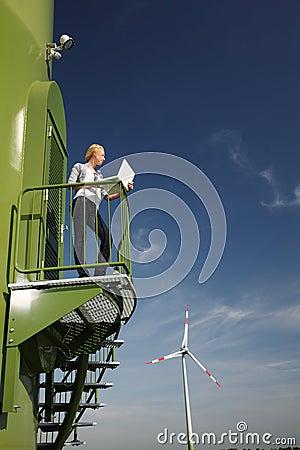 Woman and wind turbine