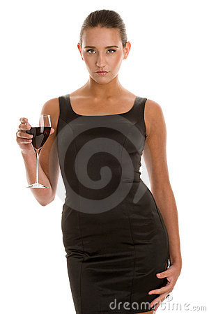 Woman in cocktail dress holding glass of red wine