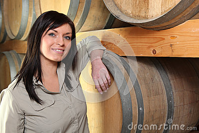 Woman in a wine cellar