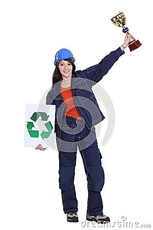 Woman winning award for recycling