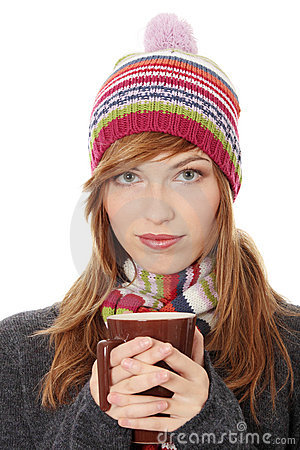 Woman with winter cap drinking something hot