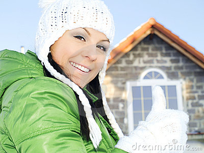 Woman in winter clothes showing ok sign