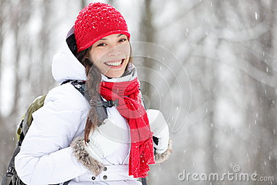 Woman winter hiking in snow