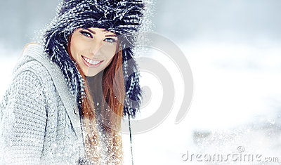 Woman winter portrait. Shallow dof.