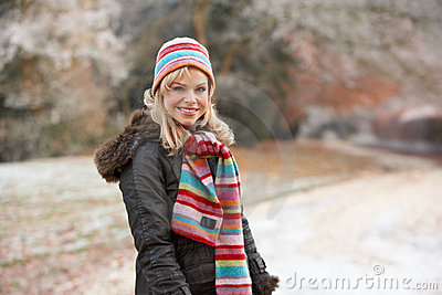 Woman On Winter Walk Through Frosty Landscape
